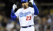 July 12, 2014; Los Angeles, CA, USA; Los Angeles Dodgers first baseman Adrian Gonzalez (23) reacts after reaching second on a double in the ninth inning against the San Diego Padres at Dodger Stadium. Mandatory Credit: Gary A. Vasquez-USA TODAY Sports - RTR3YC51